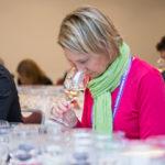 workshop person in pink tasting