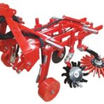 Figure 4. A Boisselet over row frame with finger weeder and rotary star tiller